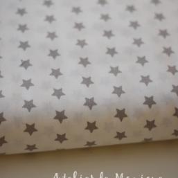 Tela blanca con estrellas gris