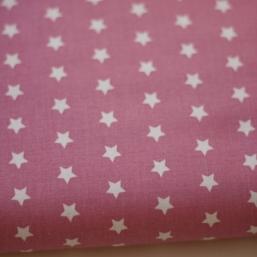 Tela rosa con estrellas blancas