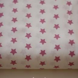 Tela blanca con estrellas rosa