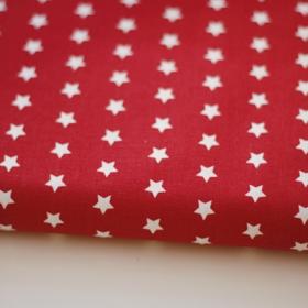 Tela en color rojo con estrellas blancas