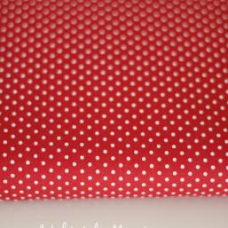 Tela roja en topos blancos