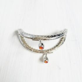 boquilla plateada ovalada (piedra naranja)