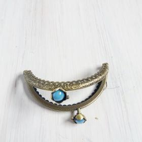 boquilla de plata para monedero redonda con flor y perlita azul turquesa